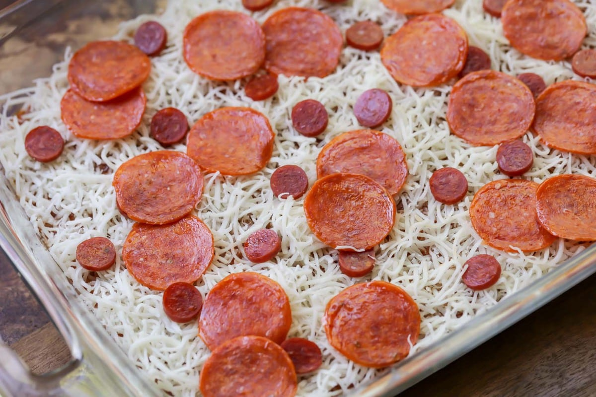 unbaked Pepperoni Pizza Dip in a casserole dish