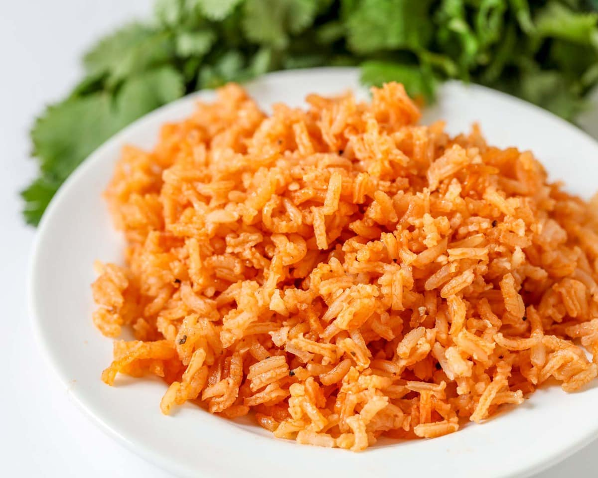 Mexican Christmas Side Dishes - Spanish Rice on a white plate