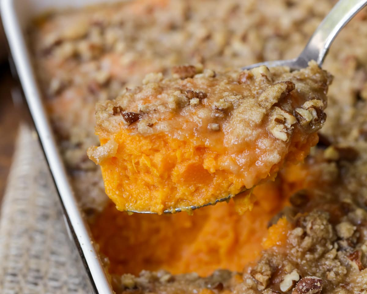 Classic sweet potato casserole spooned out