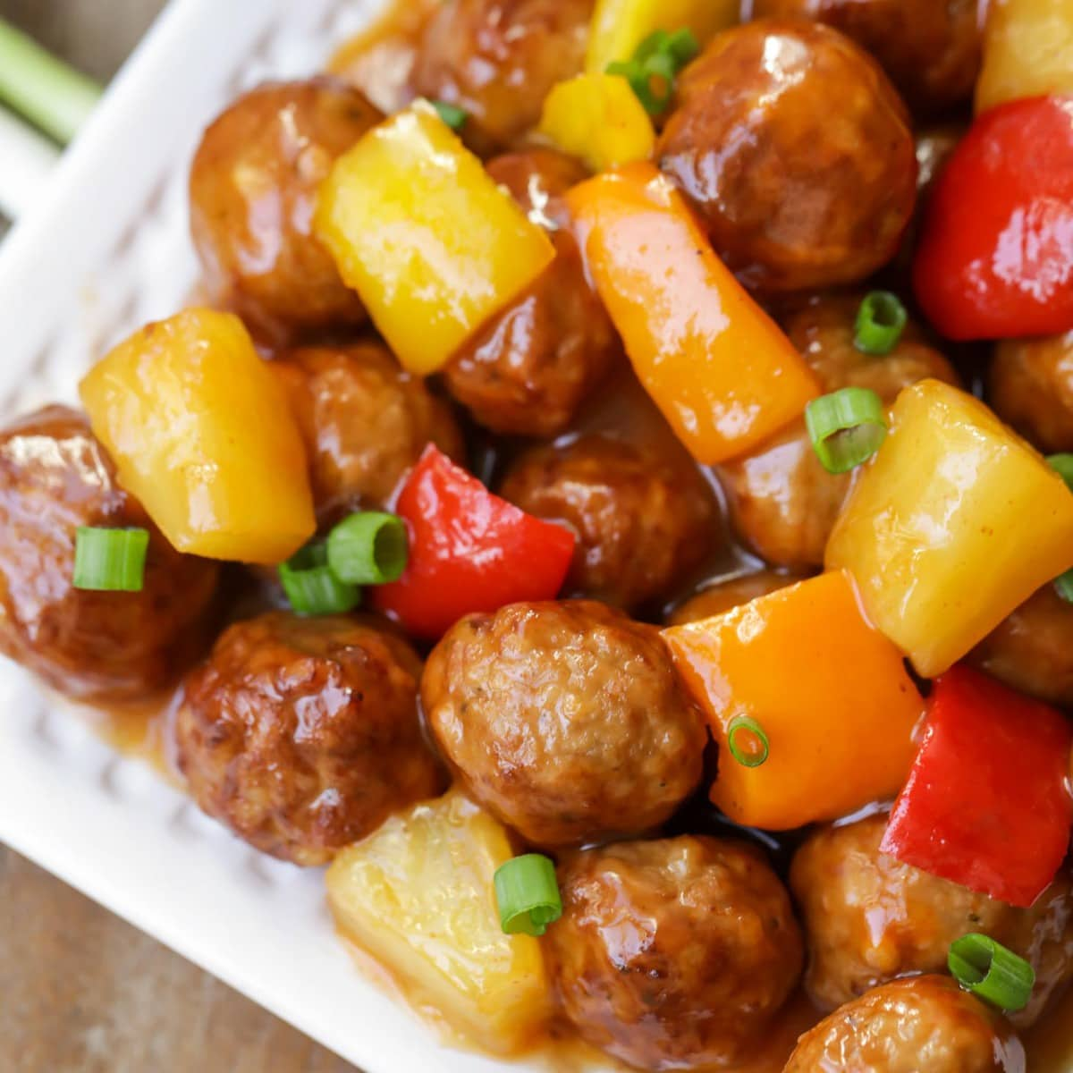 Sweet and Sour Meatballs with peppers and pineapple chunks