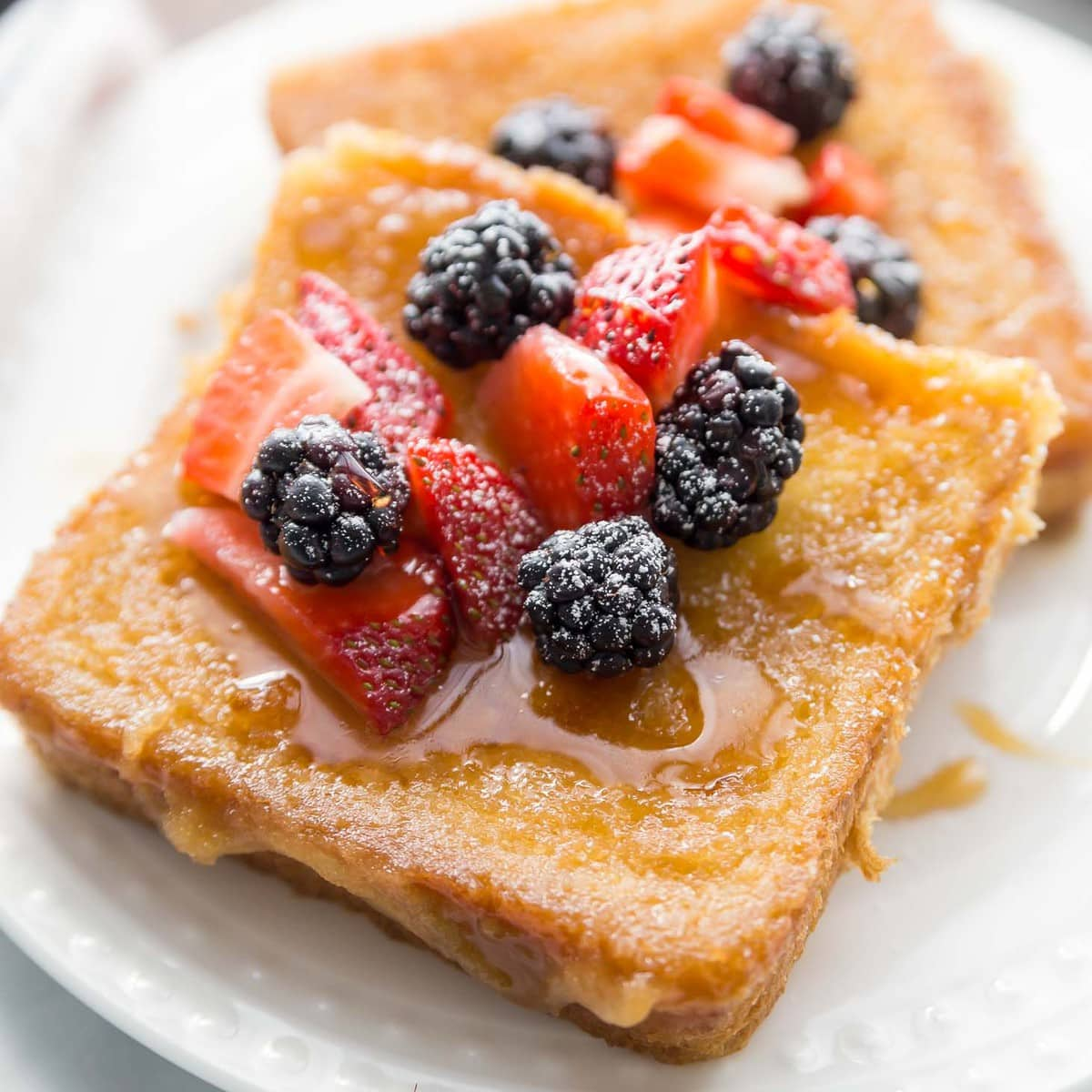 Creme Brulee French Toast with berries on plate