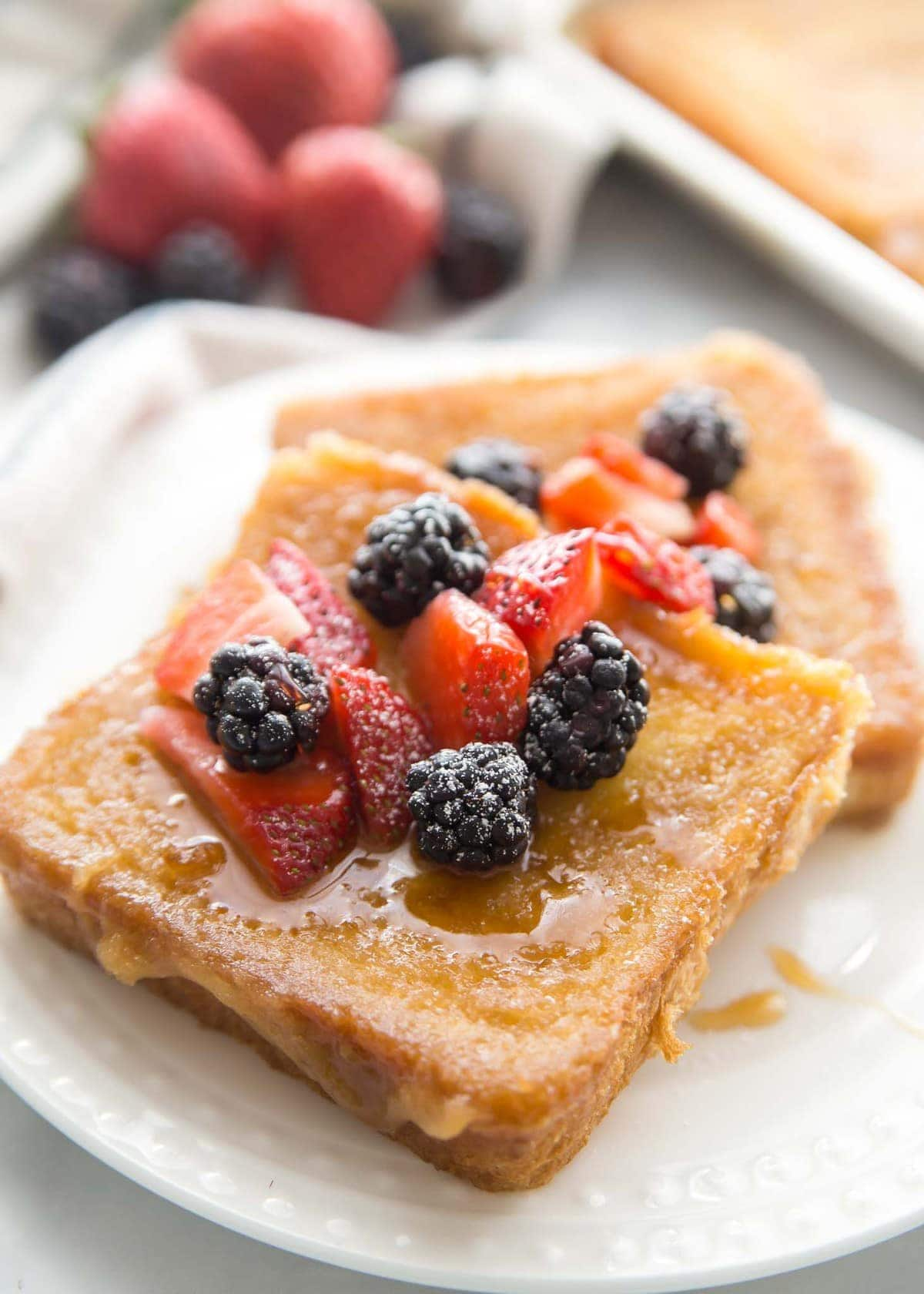 Creme Brulee French Toast recipe with berries on plate
