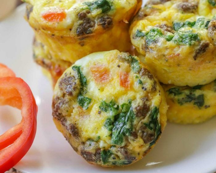 Healthy egg muffins stacked on a white plate