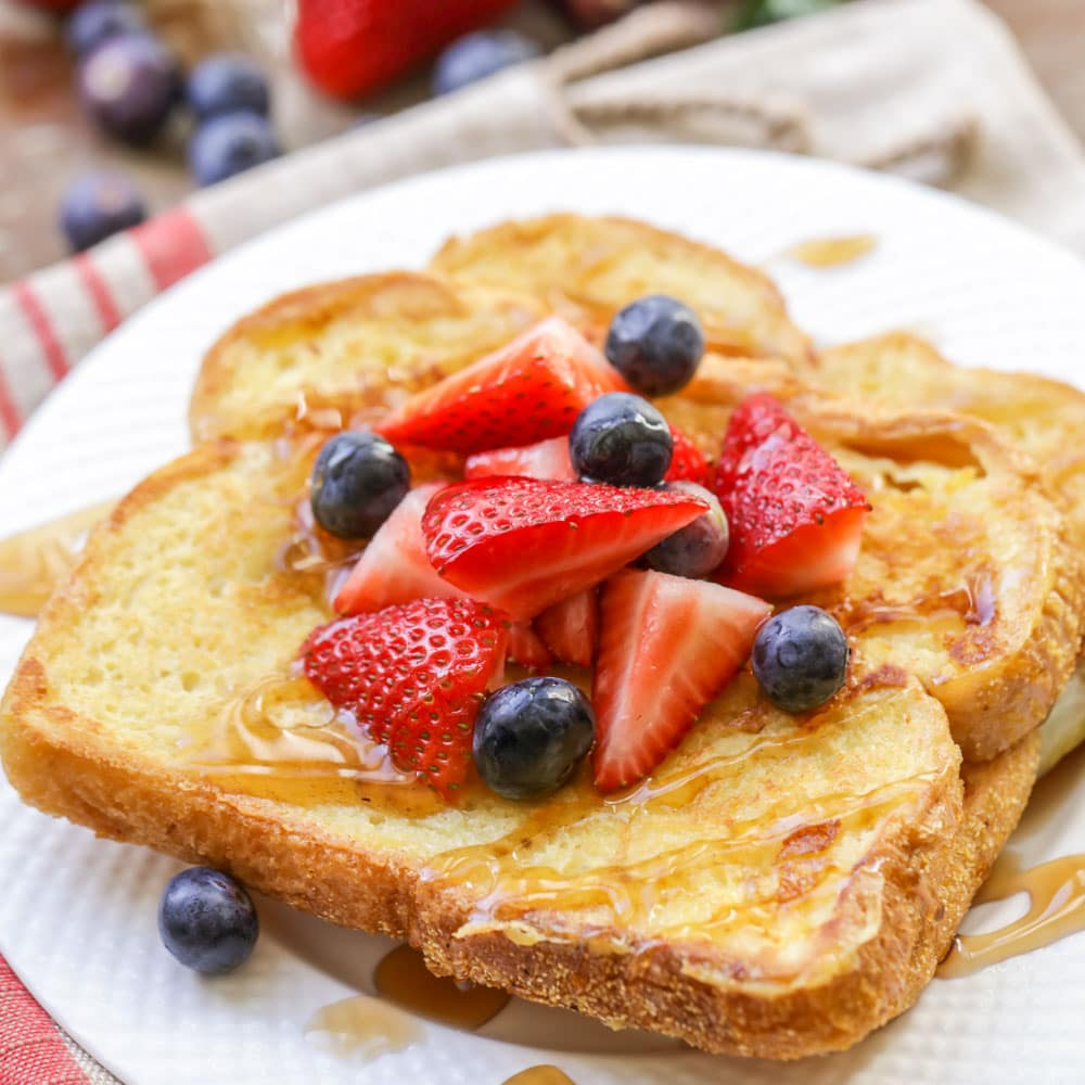 Eggnog french toast topped with berries and syrup