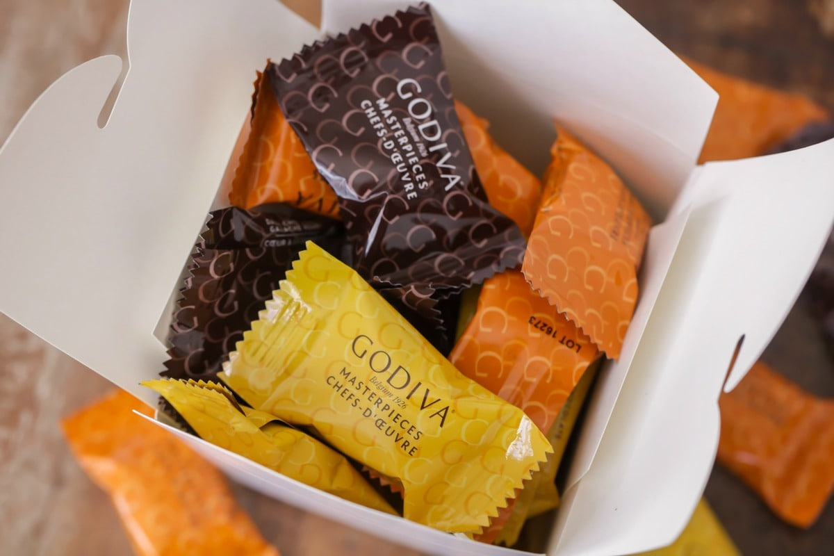 Godiva Masterpiece chocolates in a takeout container