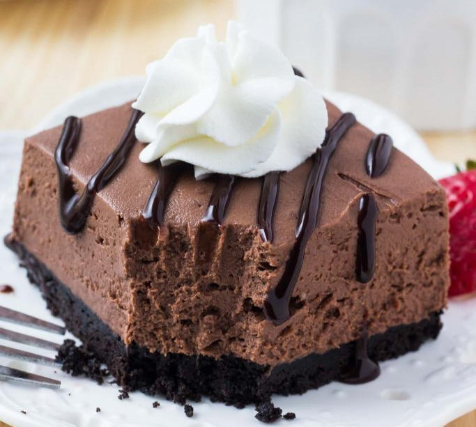 No Bake Chocolate Cheesecake with a bite taken out