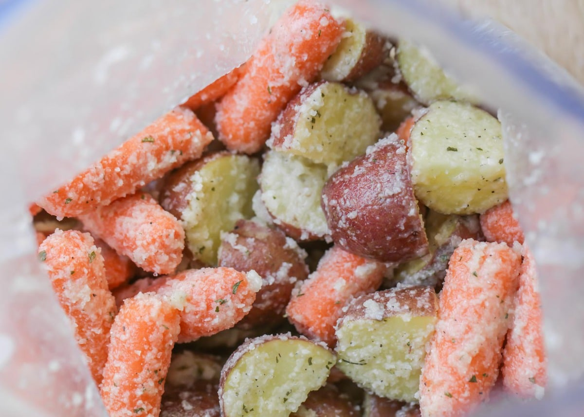 carrots and potatoes in bag coated with ranch seasoning