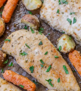 ranch chicken on pan with carrots and potatoes