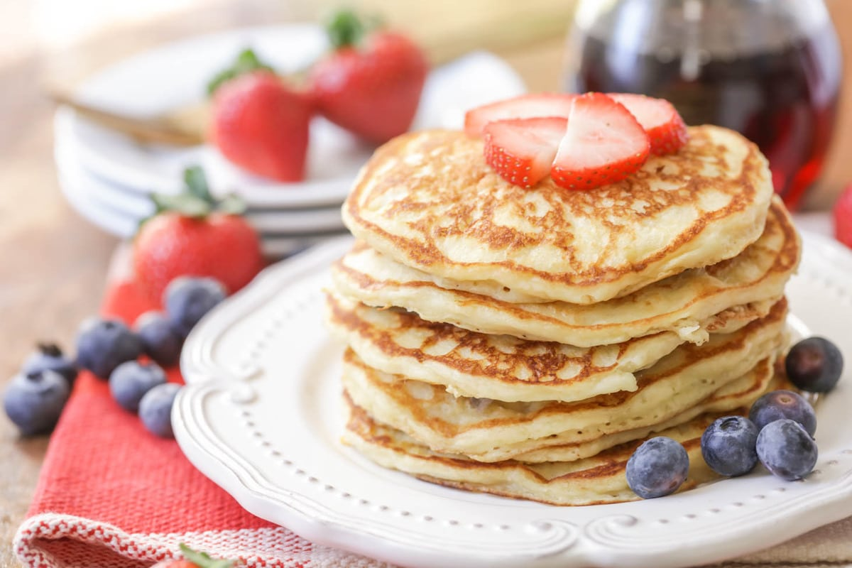 stack of Homemade Buttermilk Pancakes on white plate