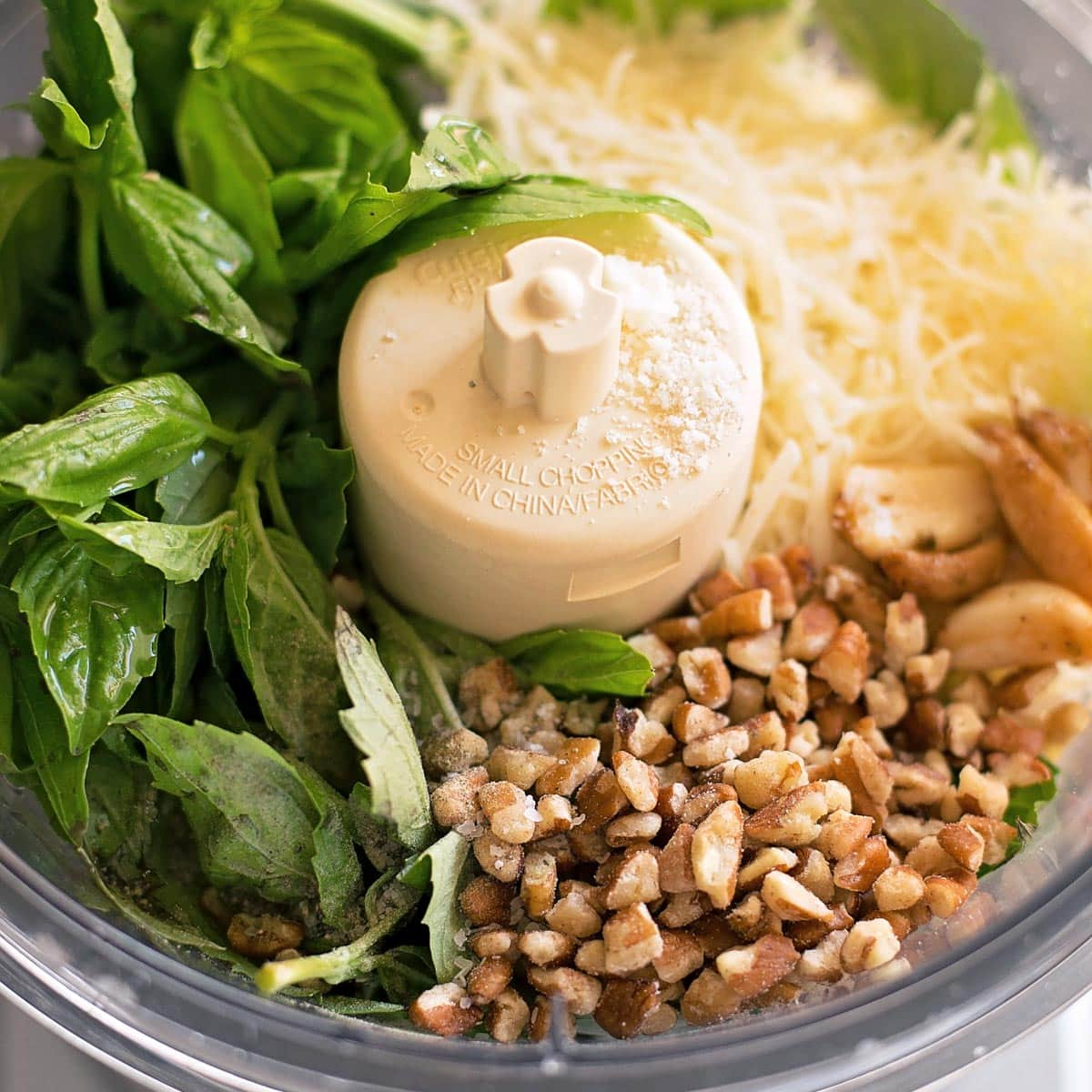 Making pesto in a food processor to combine with chicken meatballs