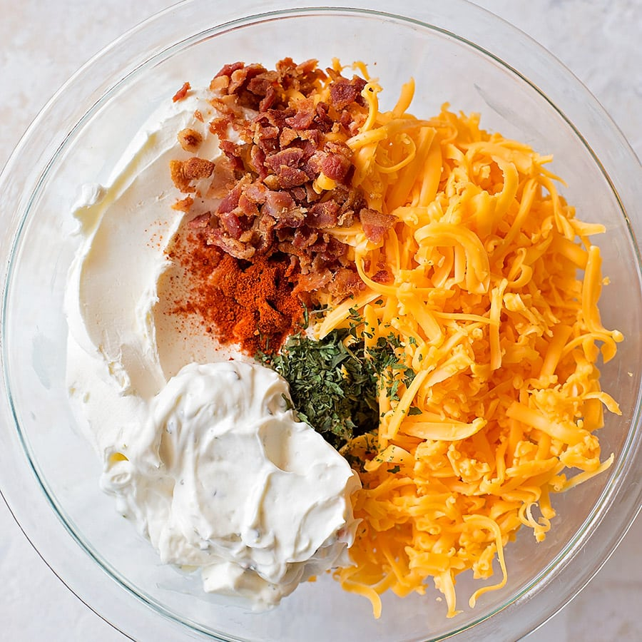 Cheese ball ingredients in a mixing bowl