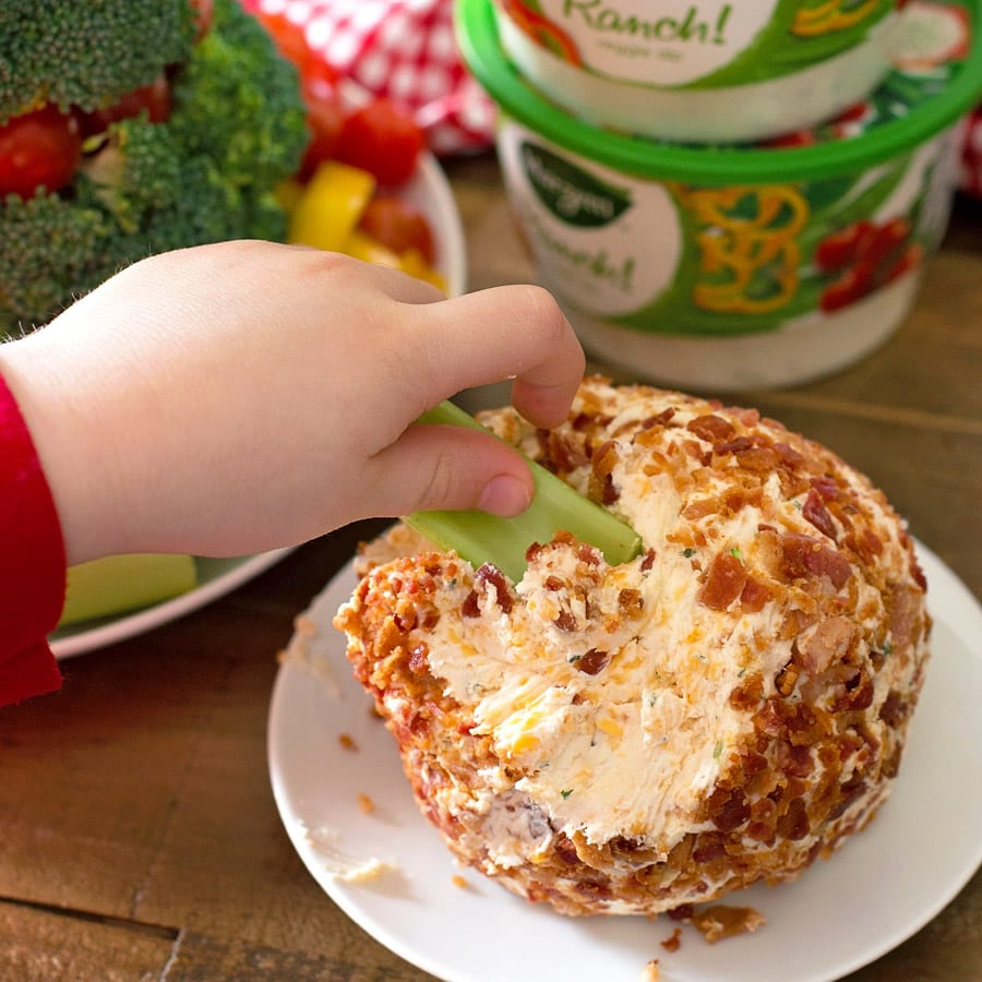 Dipping celery in a bacon cheese ball