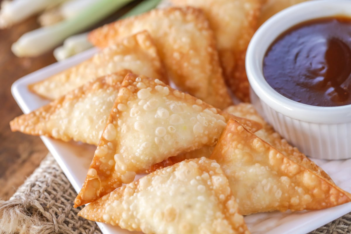 Cream cheese wontons on a white plate