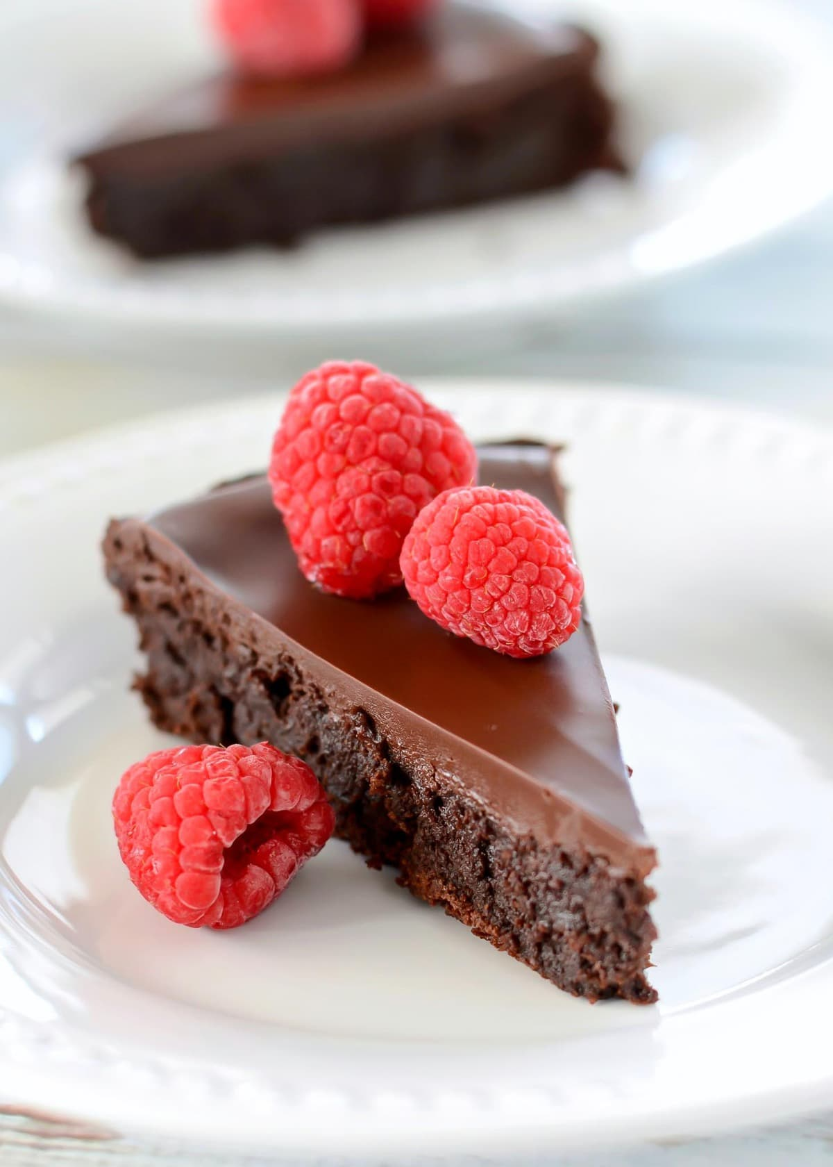 Flourless Chocolate Cake recipe with raspberries on top
