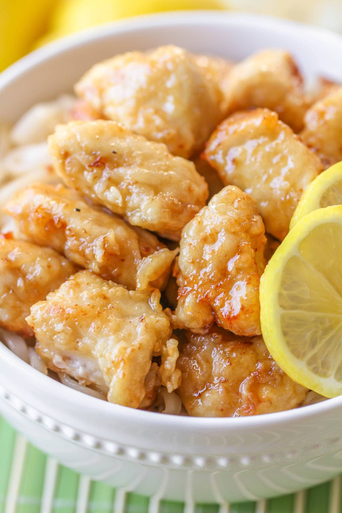 Close up of Chinese lemon chicken in a white bowl