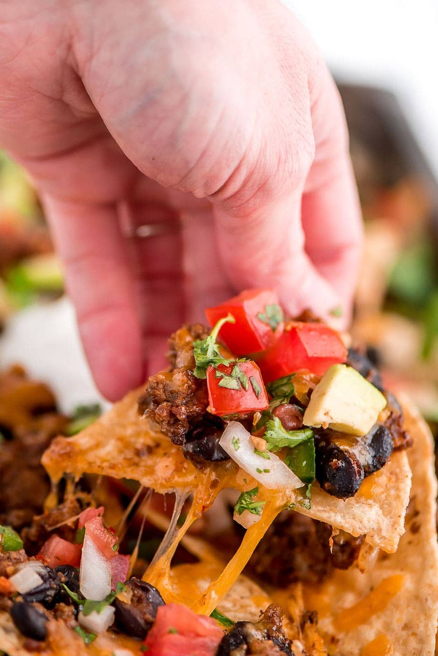 Loaded Nachos Recipe covered with nacho toppings