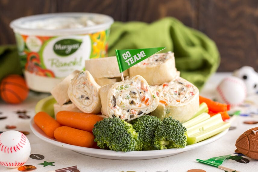 """Veggie roll ups with a toothpick flag that says """"go team"""" - a super bowl appetizer idea"""