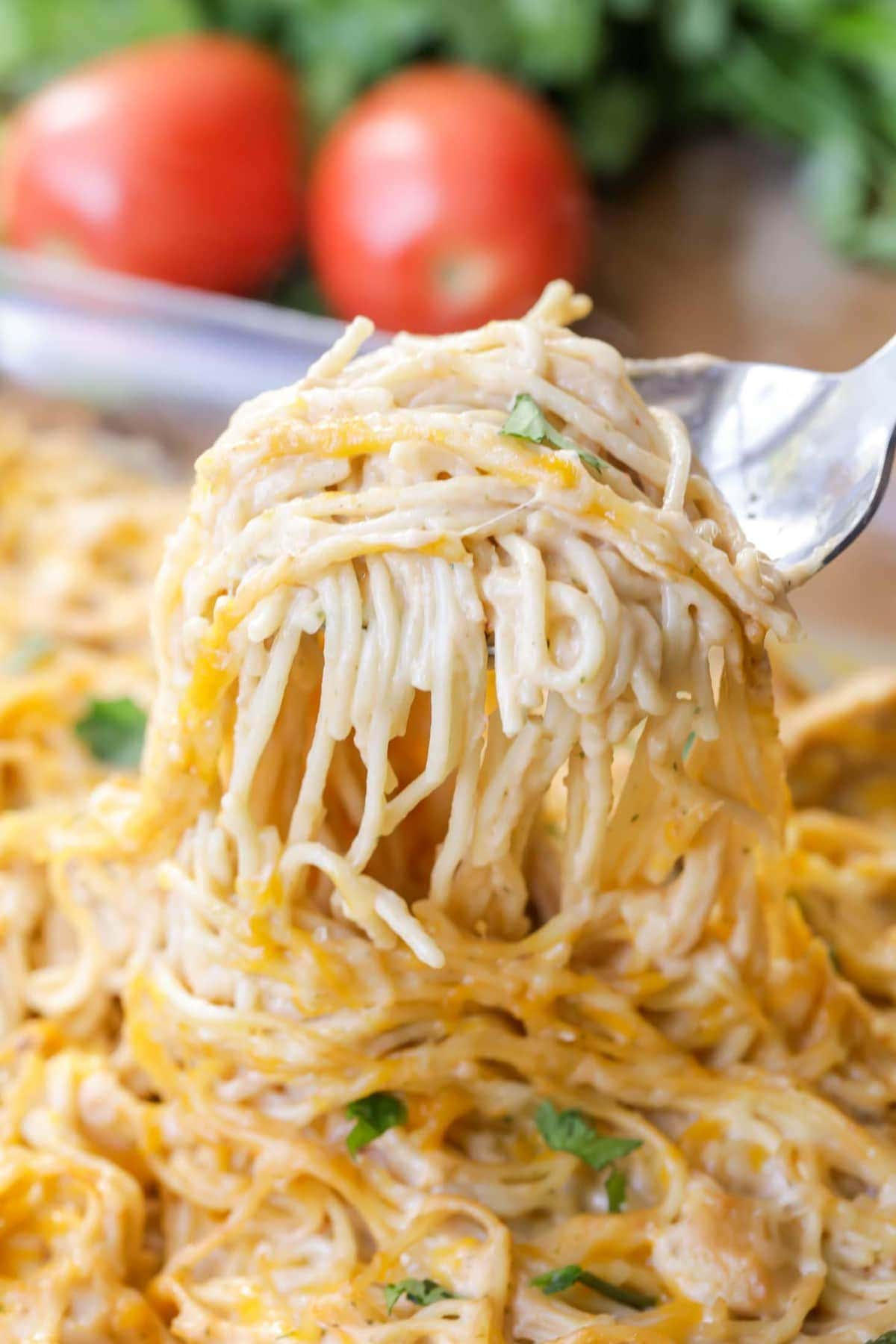 Cheesy Chicken Spaghetti on serving spoon