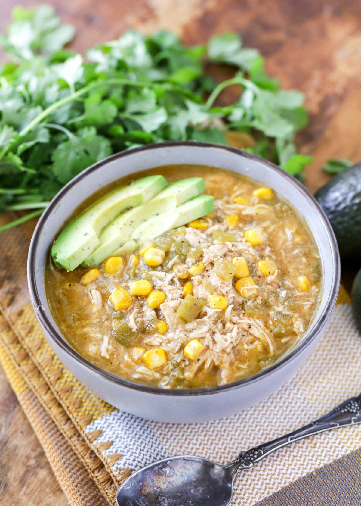 Green Chili Soup recipe with sliced avocados on top