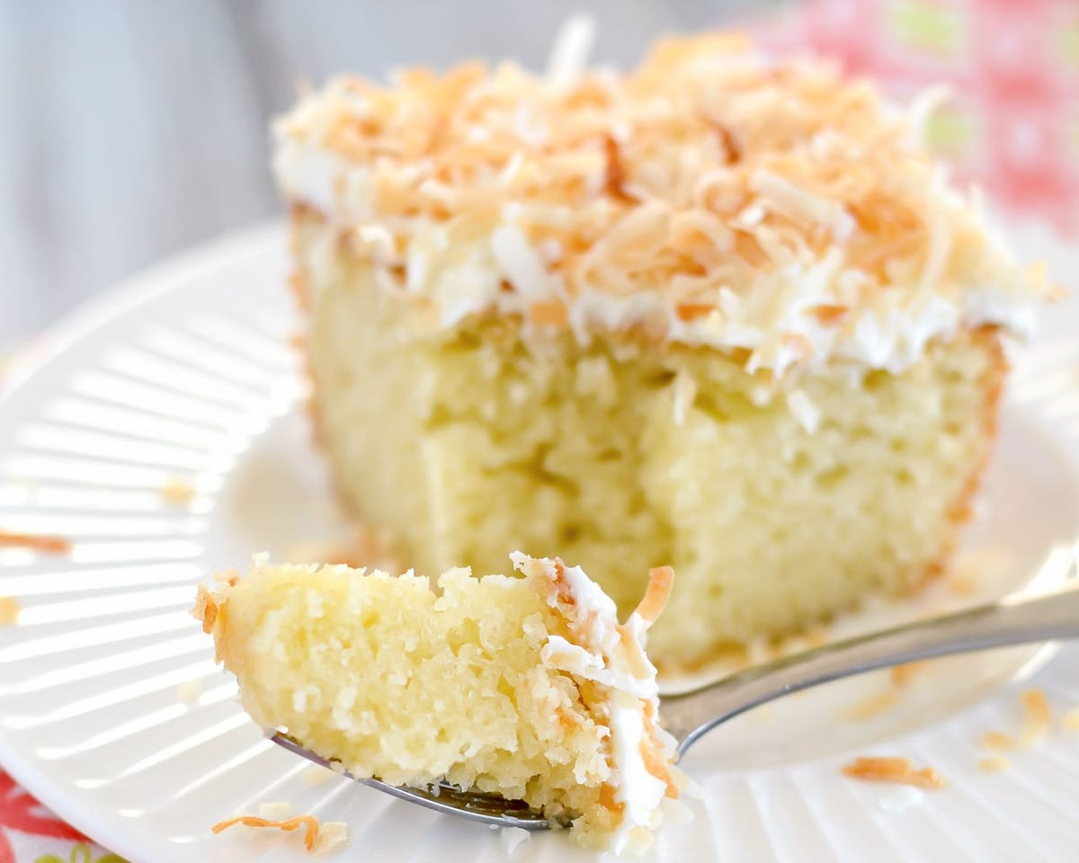 Coconut cake with a bite on a fork