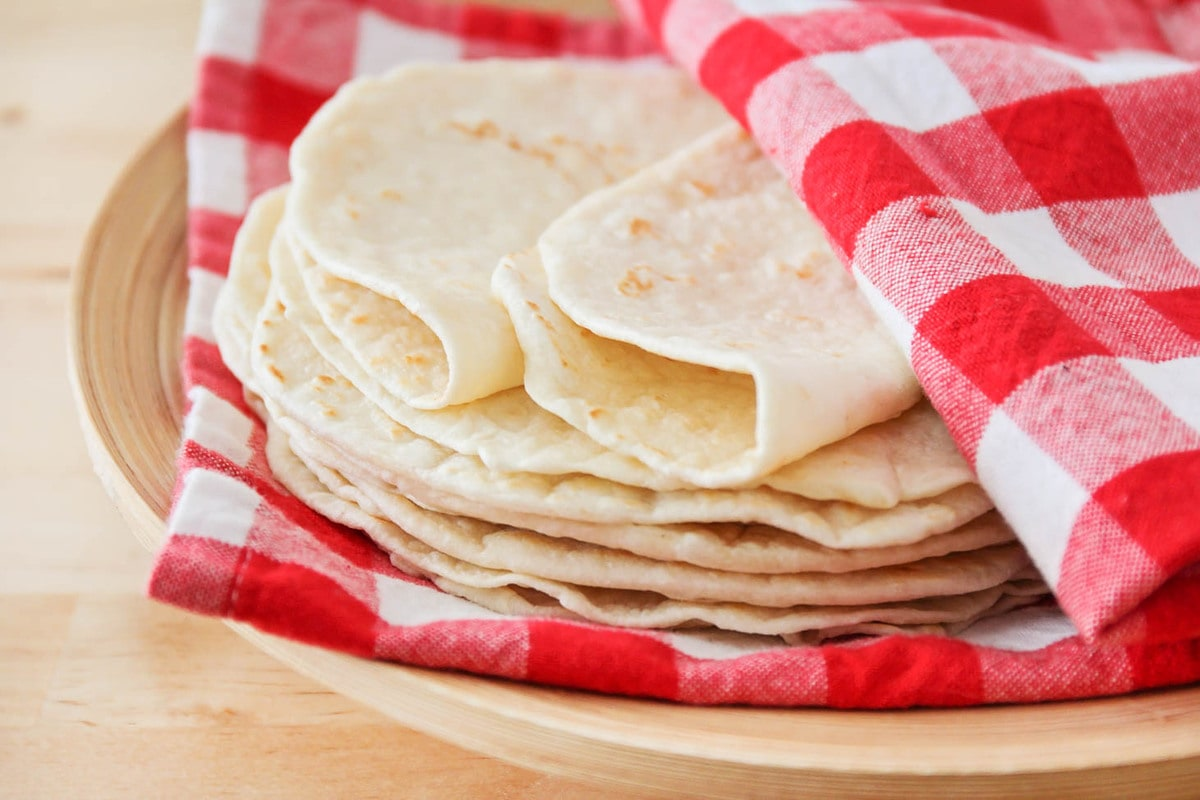 Flour Tortillas stacked on plate