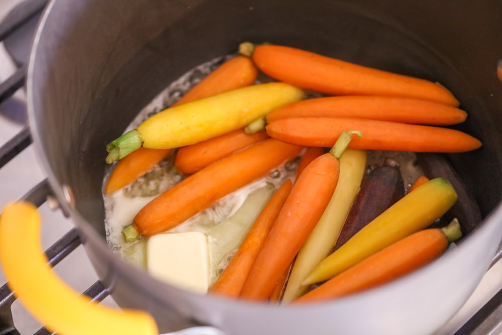 Honey carrots being cooked in pot