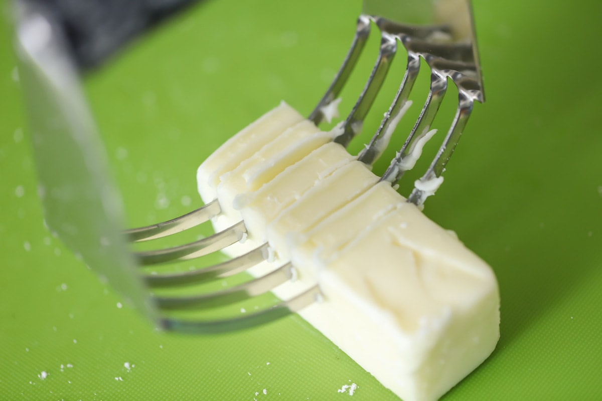 Slices of butter to top the peach dump cake