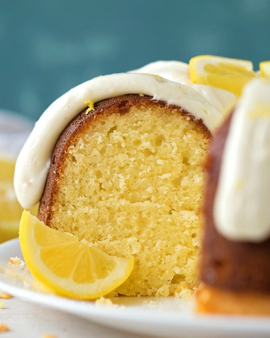 Close up of cream cheese frosting on lemon bundt cake