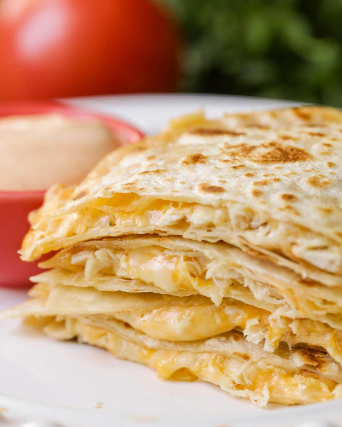 Chicken and cheese Quesadilla slices stacked on a plate