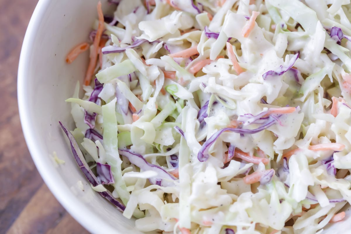 Creamy coleslaw dressing in bowl