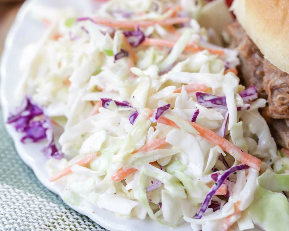 Best Coleslaw Recipe on plate with pulled pork sandwich