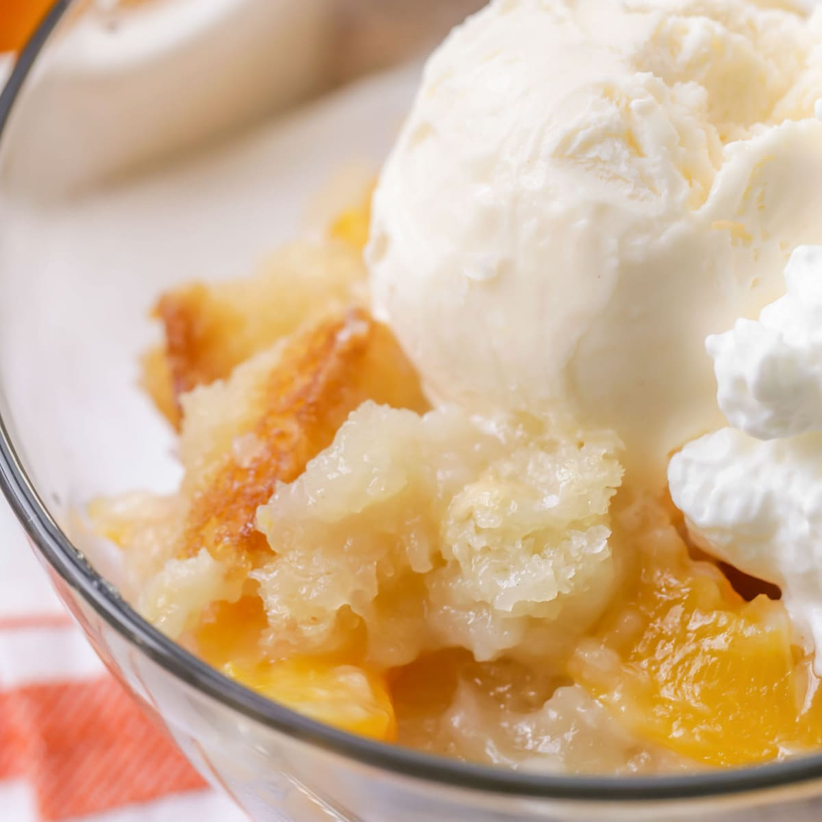 close up of Peach Cobbler topped with vanilla ice cream