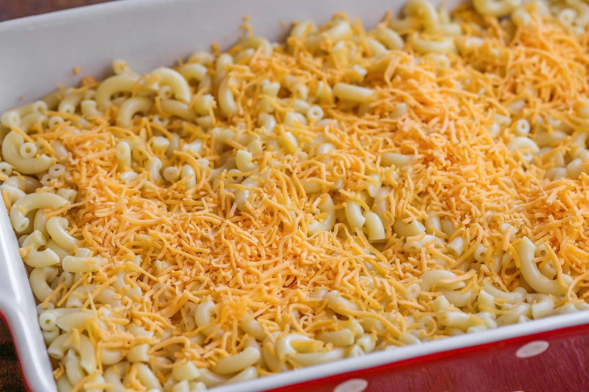 homemade mac n cheese recipe in a red baking dish