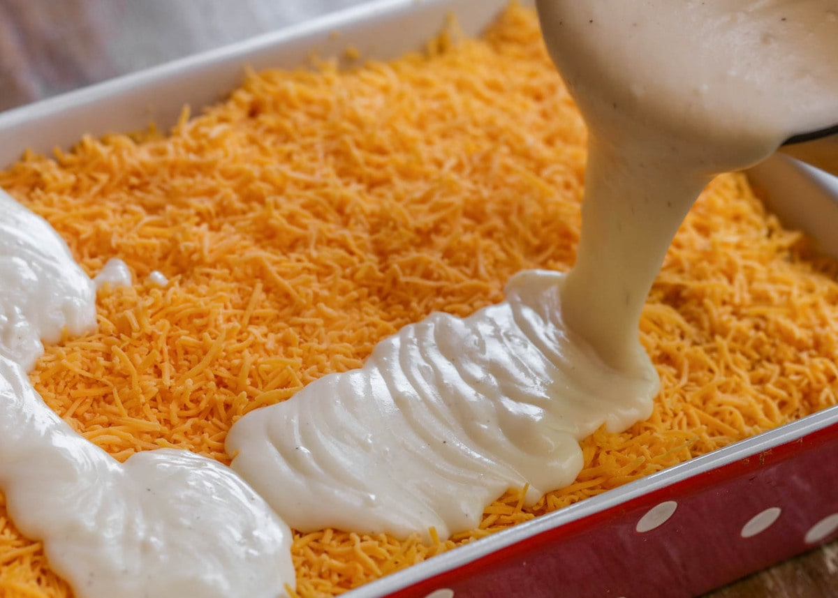 Cheesy Mac and Cheese sauce pouring in casserole dish