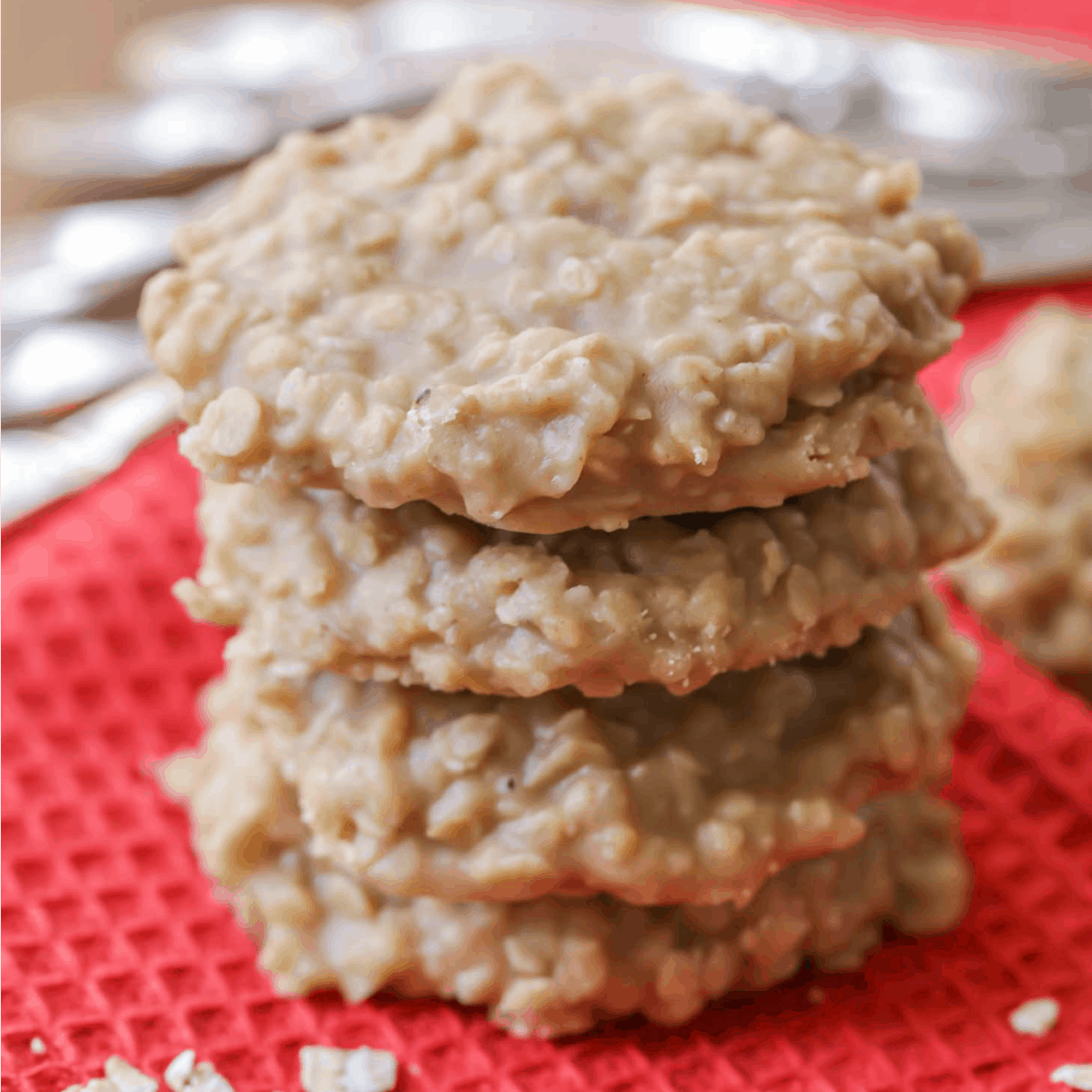 A Stack of No Bake Peanut Butter Cookies on a red dish towel