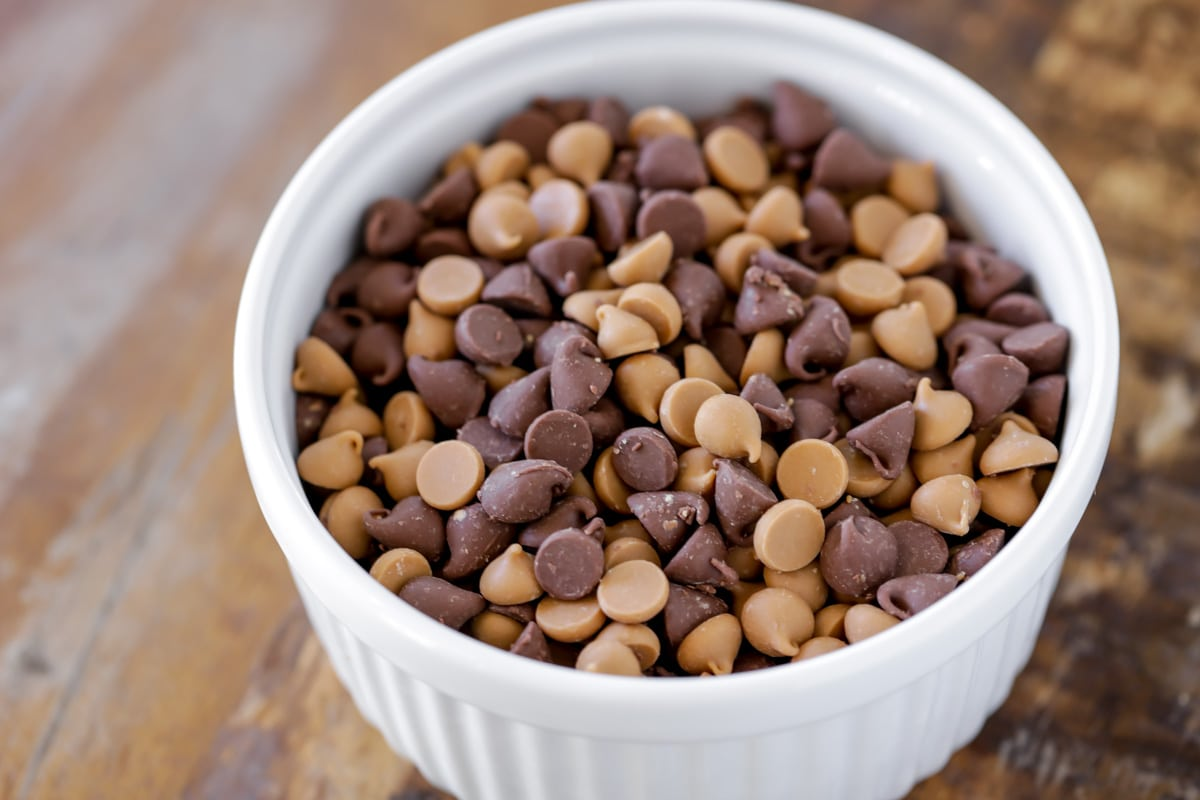 chocolate and peanut butter chips in a white bowl
