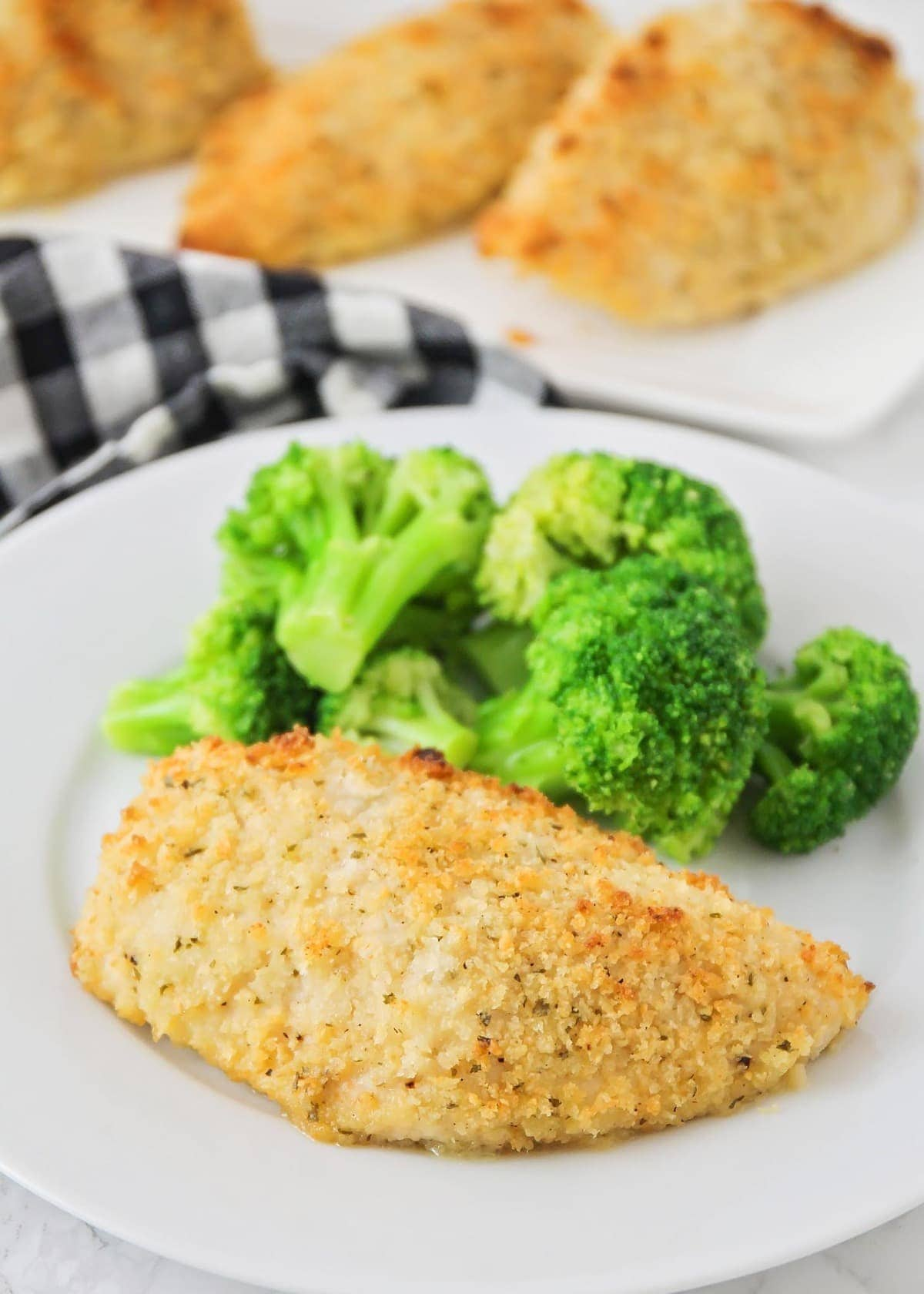Crispy hidden valley ranch chicken on a plate with broccoli on the side