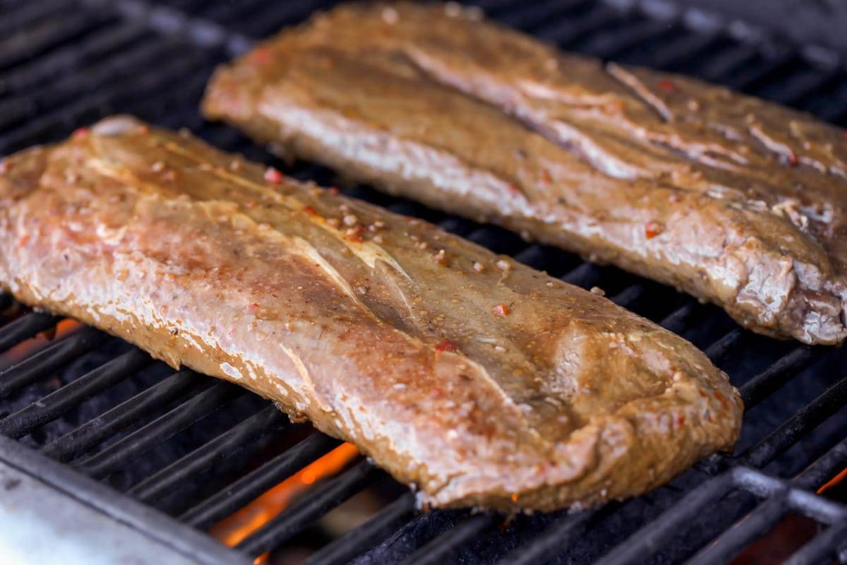 Flat iron in steak marinade on grill