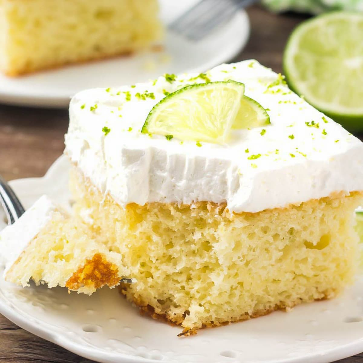 Key Lime Cake with a bite missing