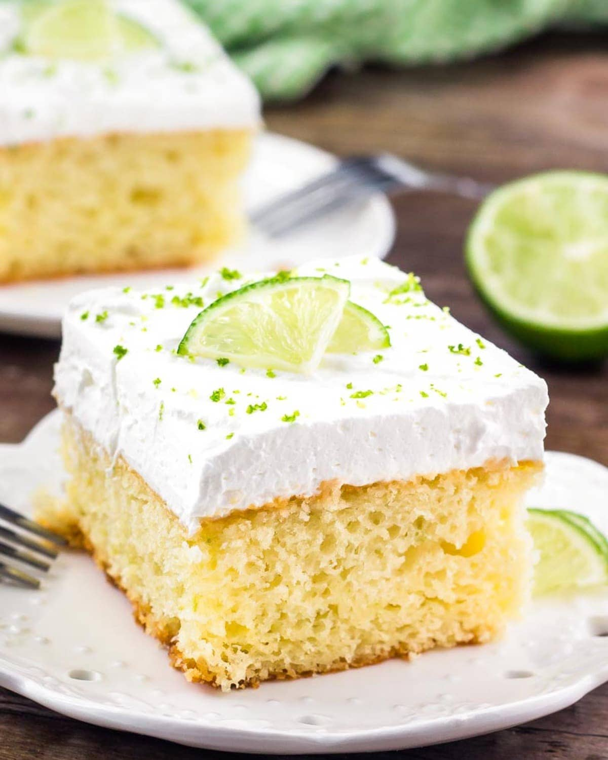 Slice of Key Lime Pie Cake on a white plate