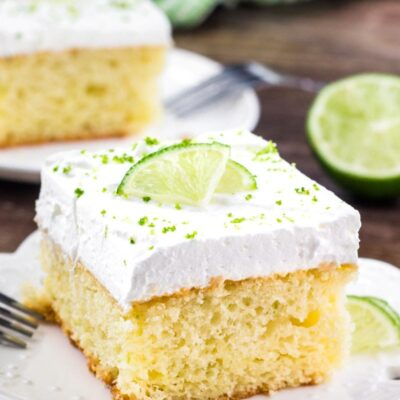 Super easy key lime cake is bursting with fresh lime flavor and topped with whipped cream. It's a delicious summer cake recipe, and if you love key lime pie - then definitely give this recipe a try.