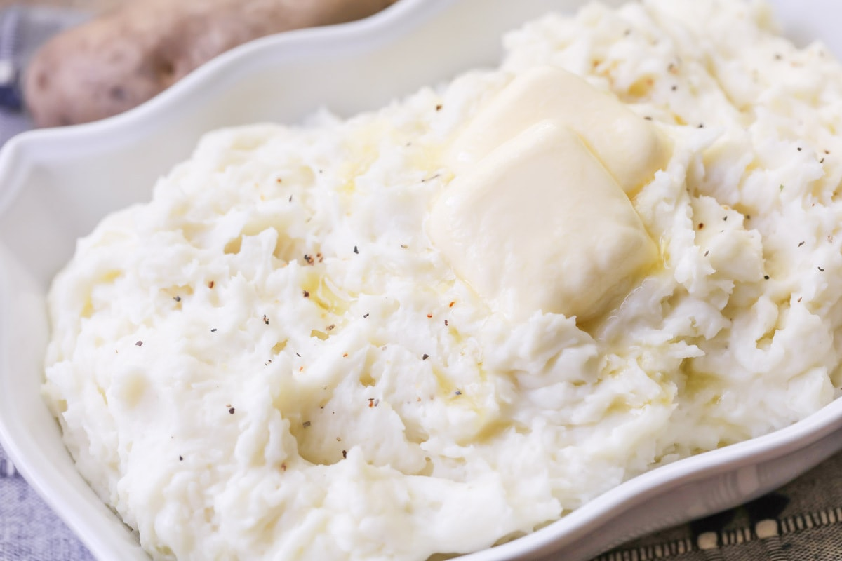Best Mashed Potatoes with butter in dish