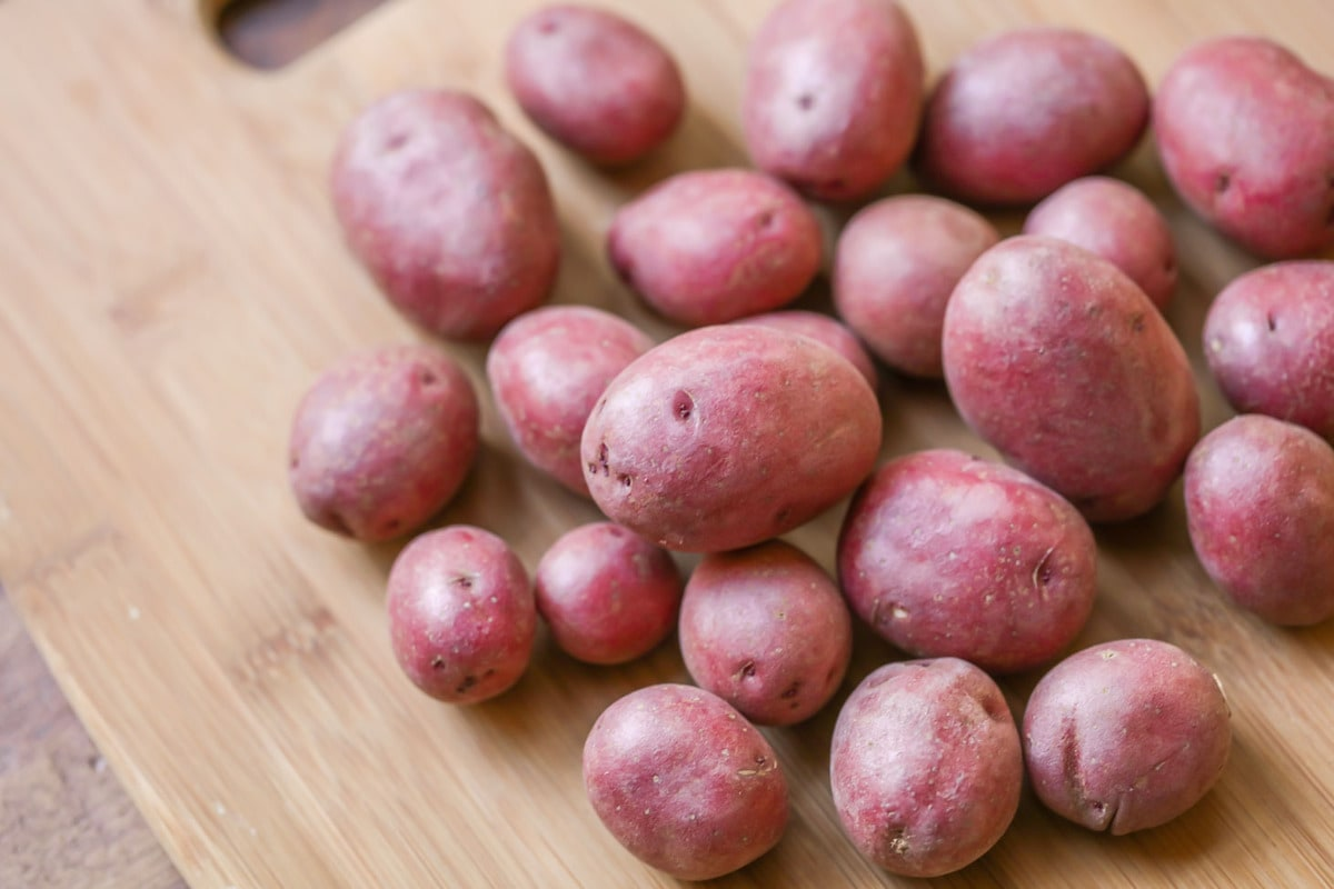 Red potatoes on cutting board