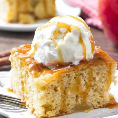 This Easy Apple Cake is extra moist and filled with cinnamon and apples. Top it off with ice cream and caramel sauce for the perfect fall treat!