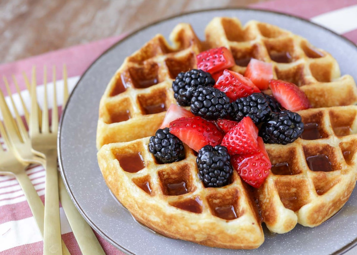Belgian waffles with berries on gray plate