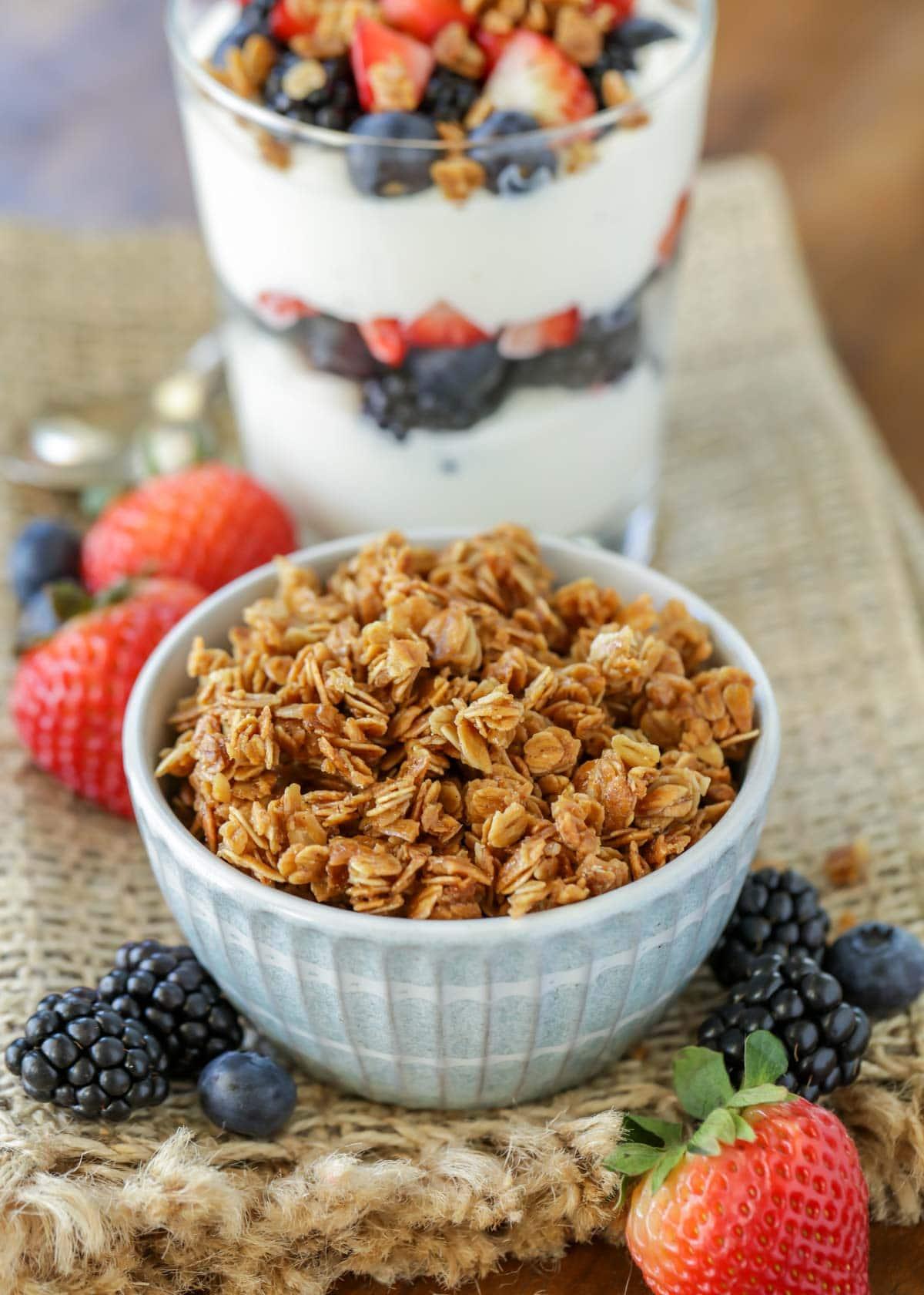 homemade granola in a blue bowl and yogurt parfait