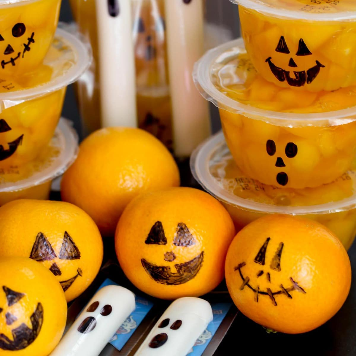 Healthy Halloween Snacks - Jack-o-lantern oranges and ghost cheese sticks