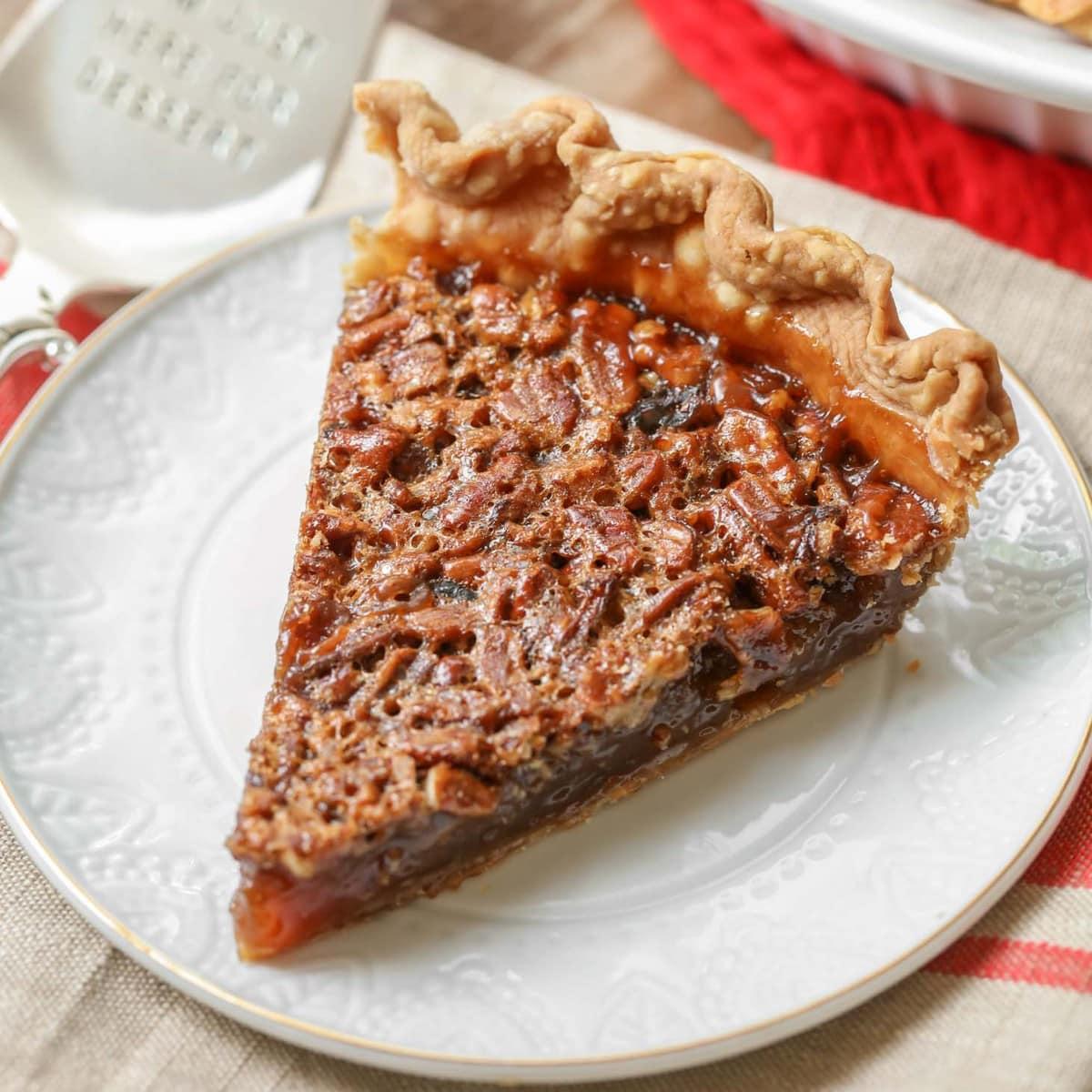 Best Pecan Pie slice on a white plate