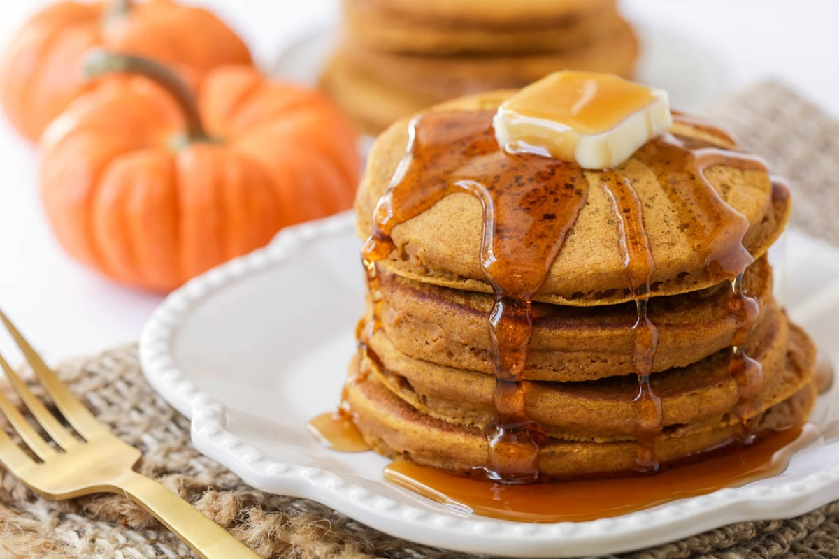 Stack of Pumpkin Pancakes covered with syrup