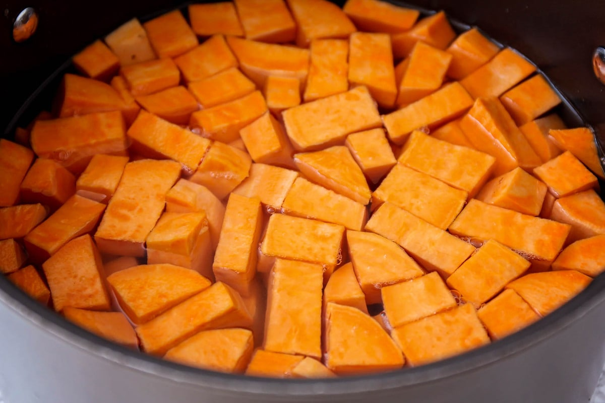 Boiling chunks of sweet potato